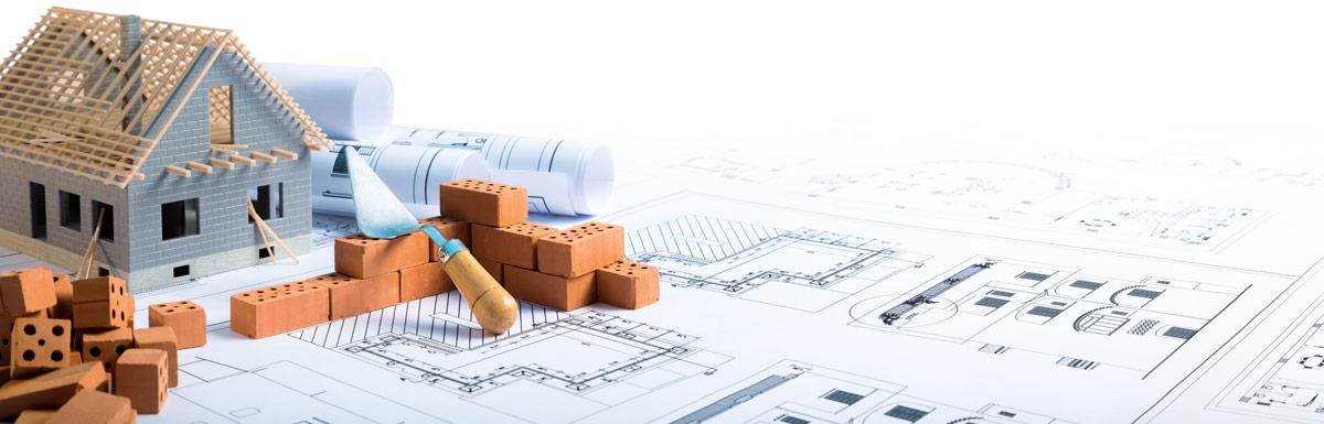 Model home with blueprint beneath it